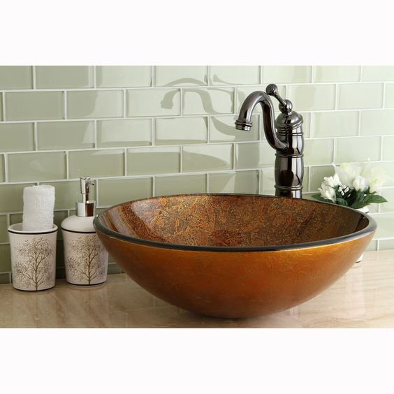 Add a striking cooper colored glass vessel sink to your bathroom decor. The rich browns and cooper are artistically handcrafted of tempered glass, giving this sink a unique design for your bathroom.