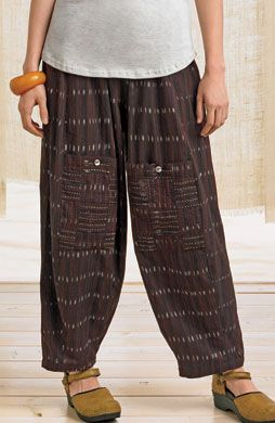 Field Pants - Brown/Black  A contemporary version of Chinese field pants. Shape bells gracefully at the knee and narrows at the ankle. Easy elastic waist, two side pockets and relaxed rise.