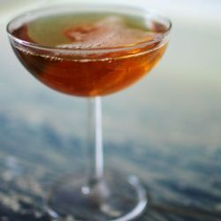 Southern Cocktails: The Seelbach. A delicious mix of Kentucky whiskey, Cointreau, bitters and champagne.