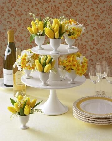 Enliven your Easter buffet with an arrangement of eggcup bouquets displayed on cake stands.: