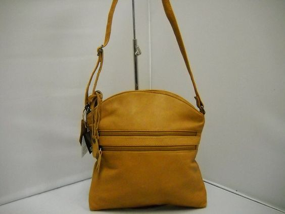 1 Gabee LW50505 -  LW50505 Tan only.  Adjustable strap. Front and back external zips.   25W x 33H