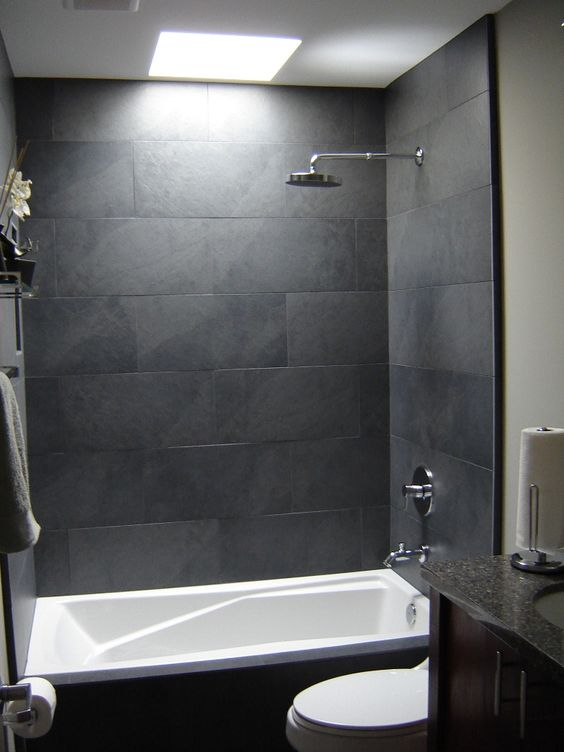 Gray tile bathroom shower grey stone tile bathroom for Bathroom ideas grey tiles