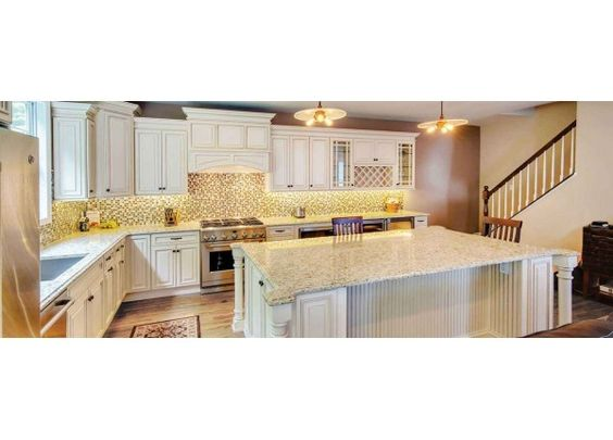 Best Raised Corner Wellington Ivory Glazed Fabuwood Cabinets 640 x 480