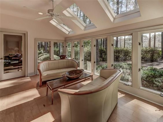 Transitional Living Room With Ceiling Fan Cathedral Ceiling Hardwood Floors Skylight Transitional Living Rooms Living Room Room Interior