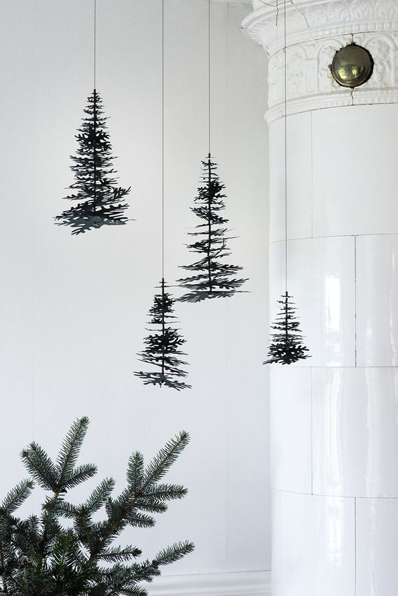 Nordic Christmas.Pine cones and graphical spruces in nice 3D DIY kits from Fab Goose, designed by Danish illustrator and paper artist Theresa Jessing. If you´re not in Christmas spirityet. This is the perfect start-up. Stylist Camilla Tange Peylecke, Photographer Gyrithe Lemche