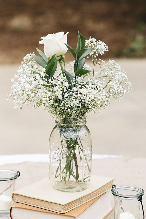 Baby's breath and roses in a mason jar—a simple, affordable wedding centerpiece: