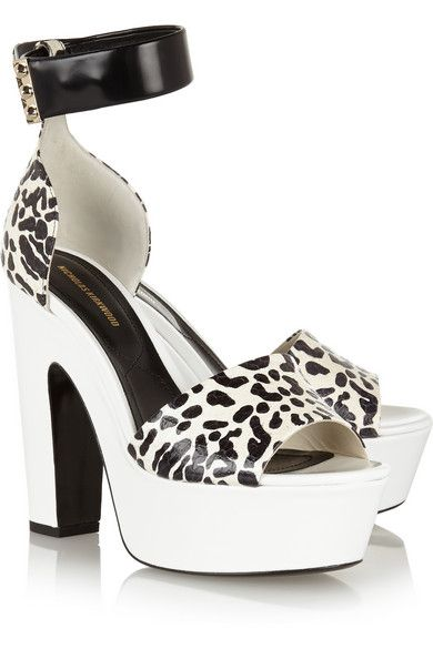 Nicholas Kirkwood's elaphe sandals are patterned with a monochrome leopard print. The sturdy heel and comfortable 45mm platform are covered in smooth white leather for a tactile contrast. Gold studs on the ankle straps add a hint of shine. Get the look at NET-A-PORTER