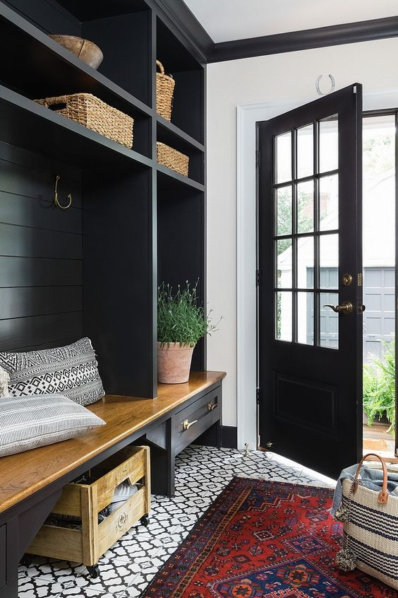 Black shiplap is the new white! An edgier take on the farmhouse trend, black shiplap is a great way to combine modern and farmhouse style. Let's admire these interiors that embrace the moodier side of shiplap! Welcome to the dark side. #blackshiplap #modernfarmhouse #shiplap
