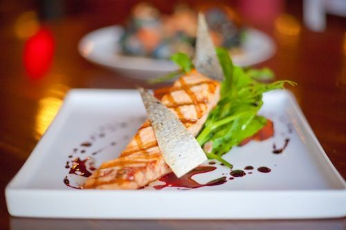 NICE PIECE FISH: A grilled salmon entree, handsomely presented. - Shanna Gillette