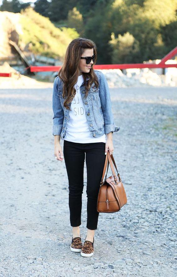 Shop this look on Lookastic: https://lookastic.com/women/looks/denim-jacket-crew-neck-t-shirt-skinny-jeans-slip-on-sneakers-tote-bag-sunglasses/5750 — Brown Leopard Slip-on Sneakers — Black Skinny Jeans — Brown Leather Tote Bag — White Print Crew-neck T-shirt — Light Blue Denim Jacket — Black Sunglasses