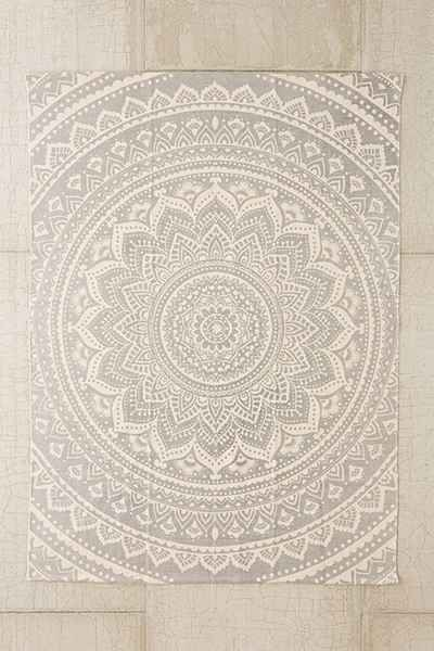 Spread some rugs all over the yard to create multiple lounging areas.  This one from UO is so affordable and incredibly detailed. Use it indoors after the party to add a subtle ethnic/boho element to your room.
