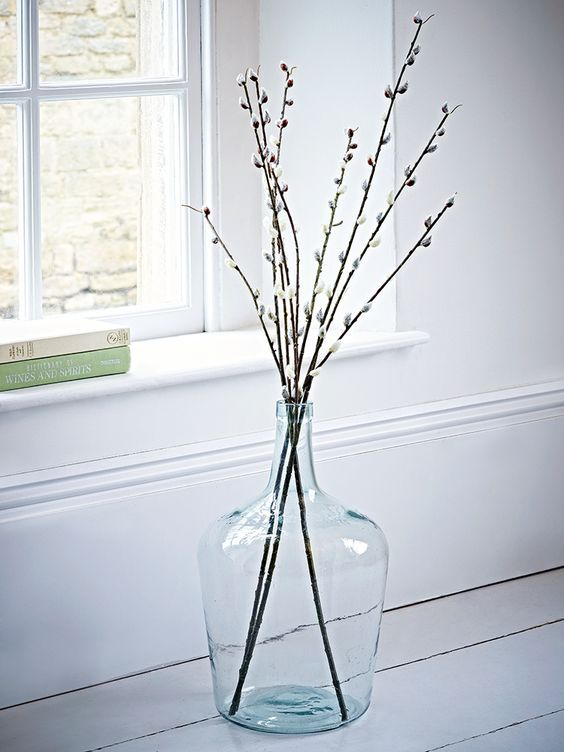 Tall faux pussy willows in glass jug: