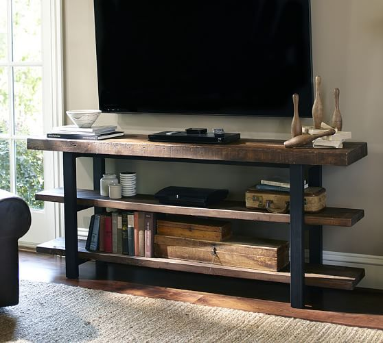 Pottery Barn's Griffin Reclaimed Wood Media Console is open to help with storage, perfect for smaller spaces.
