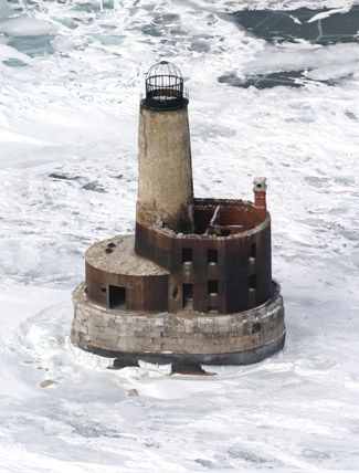 **The haunted and abandoned Waugoshance Lighthouse in Mackinaw City, Michigan. Built in 1851 - in 1900, the keeper John Herman disappeared and activity has been reported since then, like doors opening and closing on their own.**
