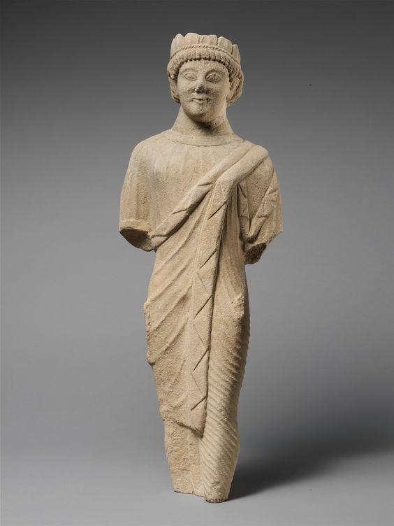 Limestone Statuette Of A Beardless Male Votary In Greek