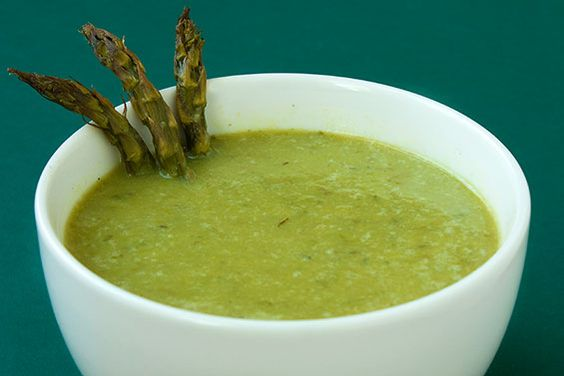 """Creamy Roasted Asparagus Soup » """"  Roasting the veggies really kicks up the flavor.  To make this soup extra hearty, feel free to add in a pound (or half pound) of potatoes to be roasted and then pureed into the soup. You could also add in carrots or celery as well!"""""""