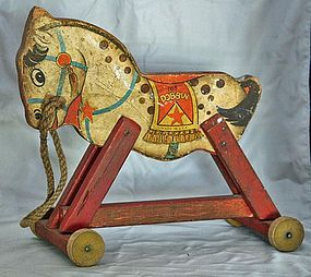 I purchased a pull toy like this one at an Italian antique market for 20 euros. It sells on this site for $98.   My horse has a tiny bell that hangs from it's mouth and the pull rope is located in between the front wheels.