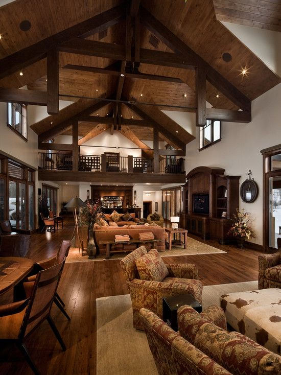 Barn style homes lodges and traditional on pinterest for Log cabin living room decor