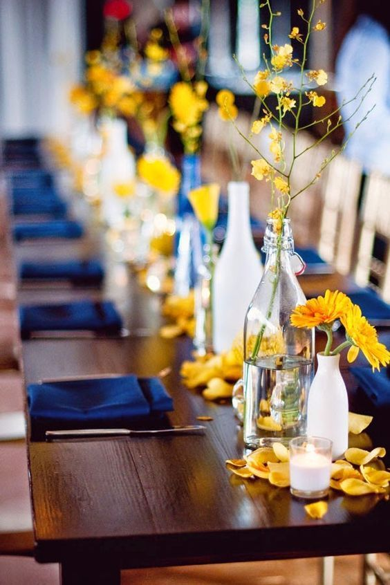 Lovely Yellow and Blue wedding tables with Rose Petals. Beautiful for an adult birthday party, rehearsal dinner, and more.