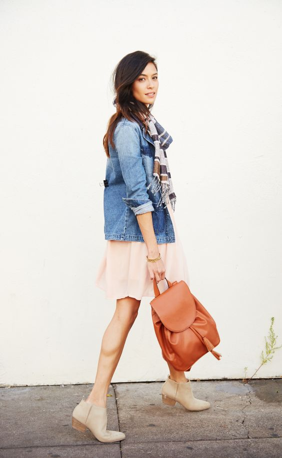 Brunch-bound babes, take note: this outfit is a must. A solid pastel dress, beige ankle boots, jean jacket and plaid scarf are a comfy and casual combination perfect for the weekend. Not only is this look incredibly cute, but dressing in layers helps you be prepared for wherever the day takes you. #Protip: For a little extra storage space, skip the purse and opt for a brown backpack.: