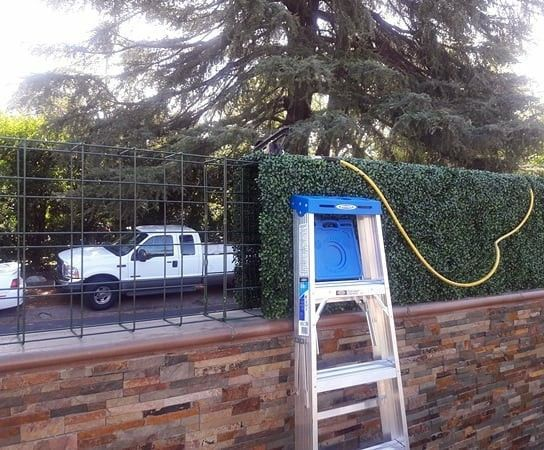 Fence Extensions With Artificial Boxwood Are Durable Lifelike And Highly Customizable Privacy Landscaping Artificial Boxwood Artificial Hedges