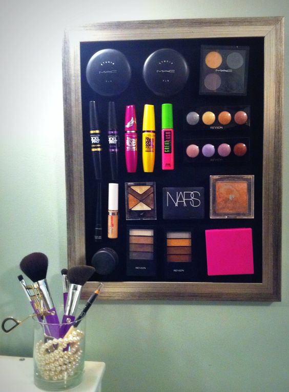 Magnetic Make-up board. Cover a sheet of metal with fabric and glue to a frame. Add small magnets to the back of your make-up products and enjoy! Great idea to keep stuff organized!