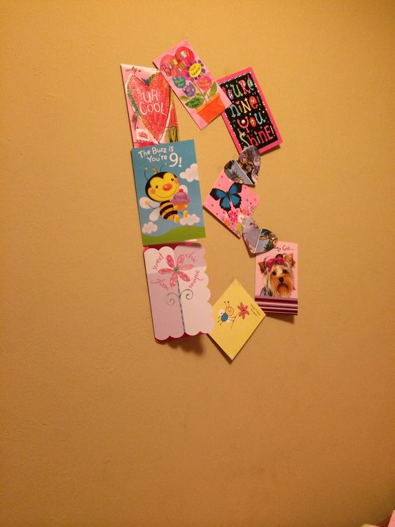 Cute wall decor using birthday cards tape and two cut out hearts. I made a B in my sisters room for her wall