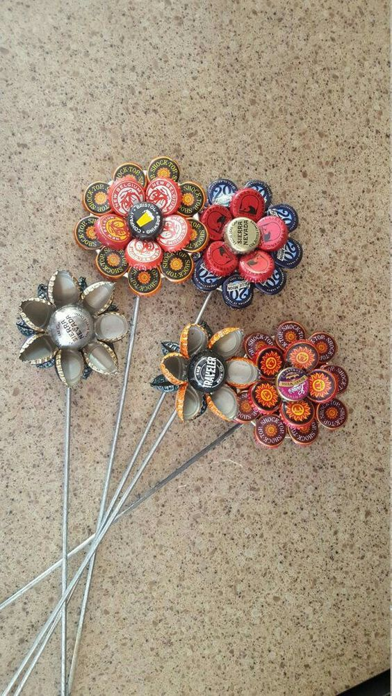 Bottle cap flowers recycle pinterest flower bottle for How to make bottle cap flowers