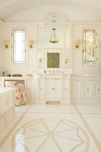 Blush pink graces the flooring and the petite shades on sconces.