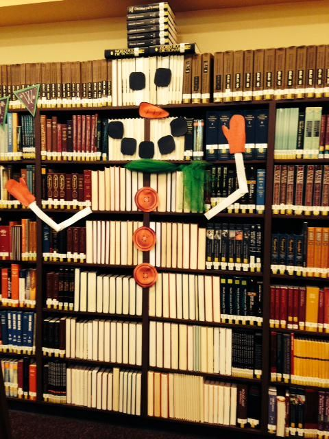 Shelf Art: Turn books around to create a snowman ... save those matching black books for the hat ... and decorate!: