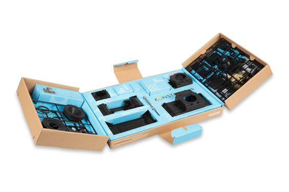 """Lomography has just released the Konstruktor Super Kit, a deluxe edition of it best-selling build-it-yourself Konstruktor Camera. The DIY kit allows crafty photographers to build their own working 35mm SLR camera.  The Super Kit comes with the same 50mm f/10 lens as the original Konstructor, but adds two new lenses: a close-up and a macro lens. It also adds a """"chimney hood"""" style viewfinder to address some complaints about the brightness of the viewfinder with the original constructor."""