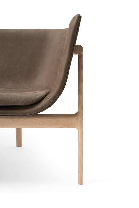 a minimal, sculptural brown sofa