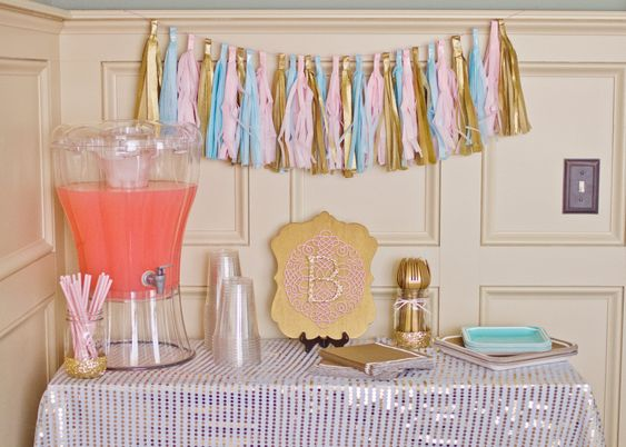 Drink stations - love this gold sequin tablecloth and tassel garland!: