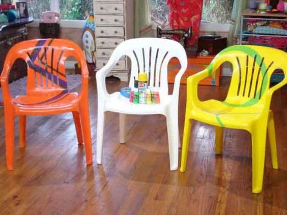 Rejuvenate boring everybody-has-'em resin patio chairs with a few coats of paint and a little artistic imagination, from DIYNetwork.com.