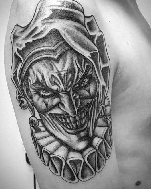 50 Jester Tattoo Designs For Men Entertainer Ink Ideas Suprise Coloring Nails Ideas For Youths Tattoo Makeup N In 2020 Jester Tattoo Joker Tattoo Clown Tattoo