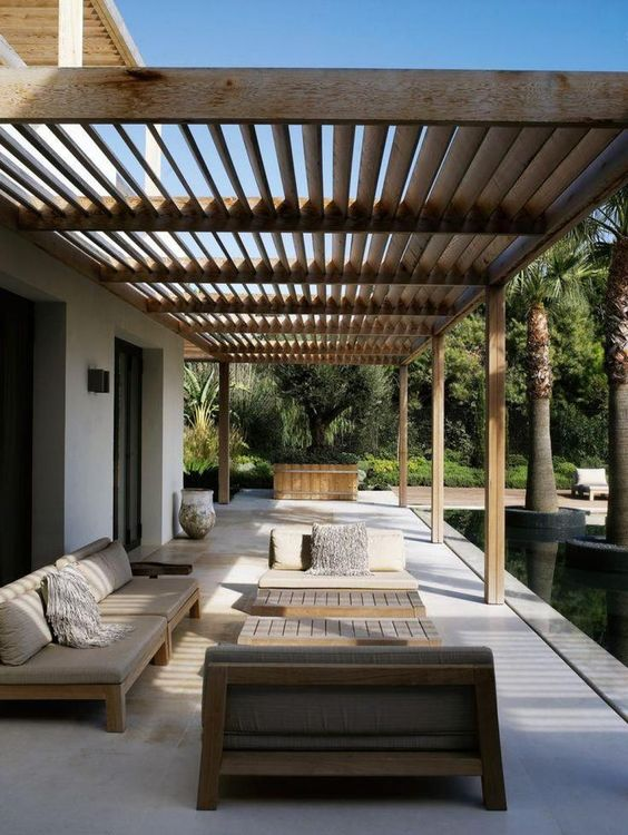 Backyard Long Patio With Wooden Furniture And Beautiful Modern