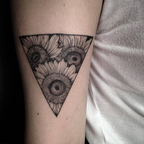 Sunflower triangle tattoo on the right bicep.