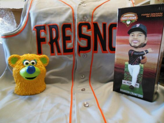 On the Fresno Grizzlies' Fan Appreciation Day on Sept. 2, 2013,  I won a Brandon Crawford bobblehead and a Parker (mascot) bank.  The sleeveless Fresno jersey was from a contest for donating to the Grizzlies Community Fund (charity).