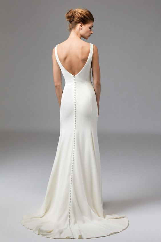 Watters Leona wedding gown -- Clean, classic and chic. Leona is ideal for the modern minimalist. This V-Neck, Silk Georgette gown is lined with Stretch Satin, creating a light and flattering feel. Its simple look makes accessorizing a dream. Sweep Train.