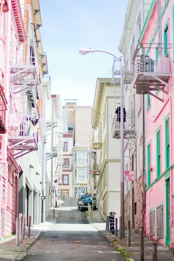 A San Francisco street with a pink facade.
