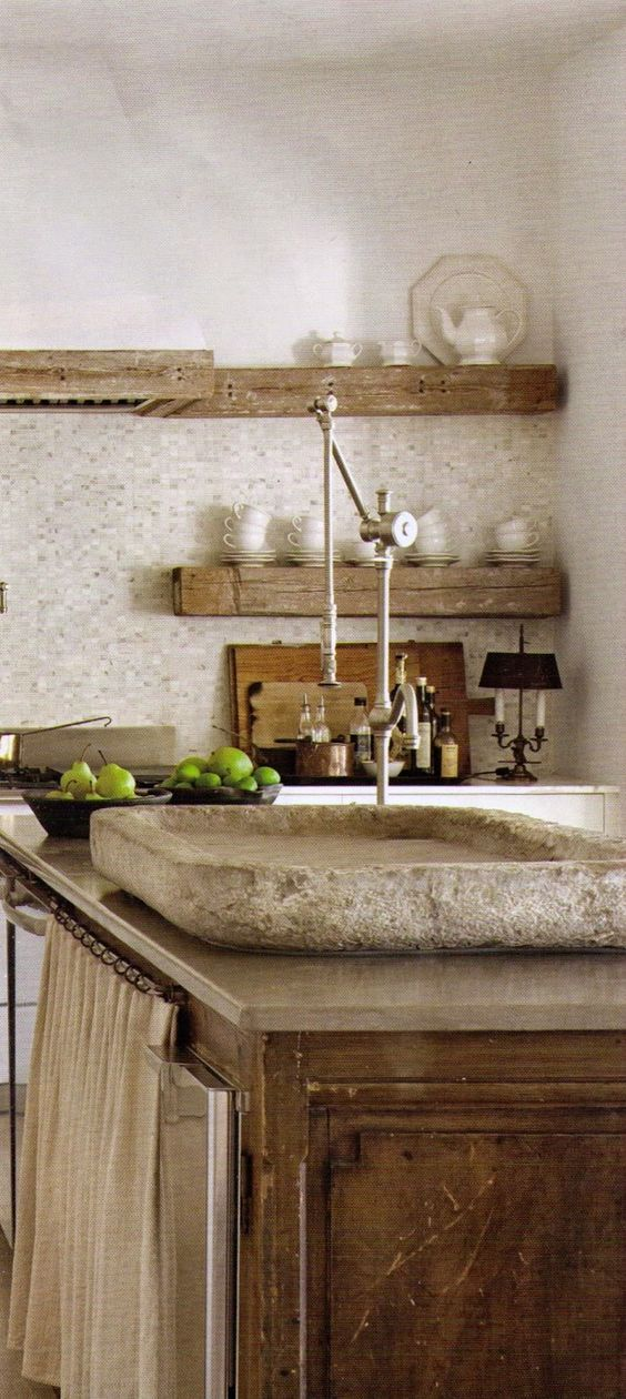 Lovely French Farmhouse kitchen design by interior designer and editor of Milieu magazine, Shannon Bowers. This European inspired sophisticated kitchen features an antique stone sink, rustic wood open shelves, and a neutral palette. #frenchfarmhouse #frenchcountry #kitchendesign #kitchendecor #kitchenideas #interiordesignideas #interiordesigner #refined #rusticdecor #European #antiques