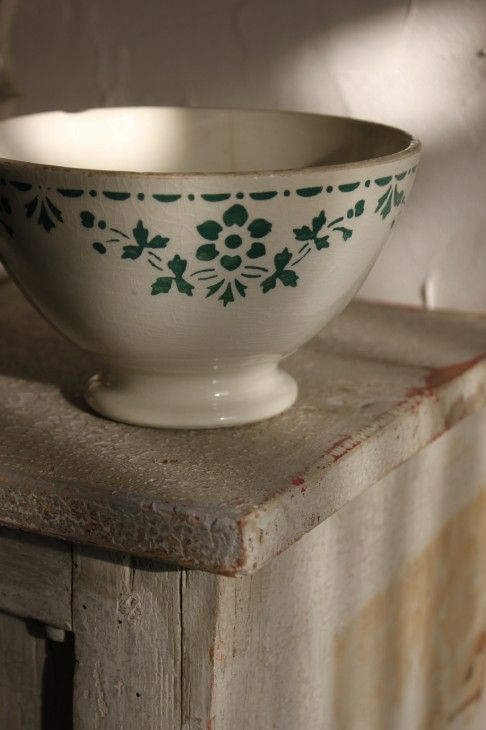 white café au lait bowl with green floral trim