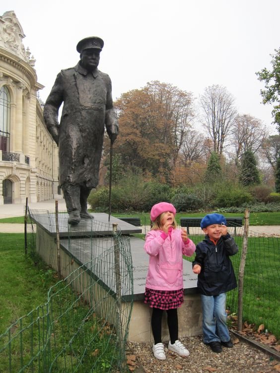 Kids by Churchhill statue in Paris, France