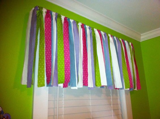 Valance from fabric strips made for my daughter's room.  Thanks, momtastic.com!  Love it!