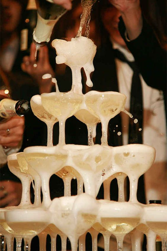 Don't forget the classic champagne tower!   14 Ways To Bring Vintage Glamour To Your Wedding