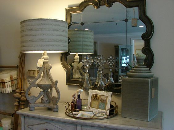 Elegant mirror goes well with this lamp above this lovely chest!