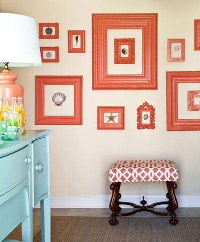 recycled frames (unified with the same color) and seashells as wall art.