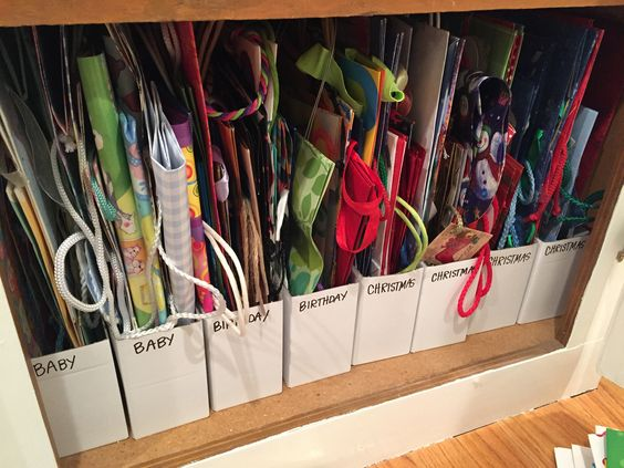 Gift bag storage using IKEA magazine holders.