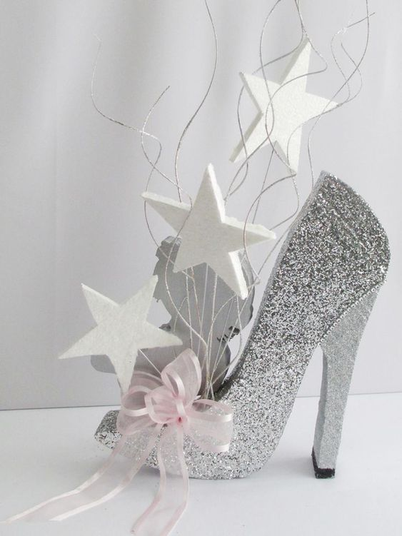 Shoe centerpiece idea > high heels. Beautiful 4 bridal shower or birthday party - sparkly silver stiletto with white stars and a pink ribbon.: