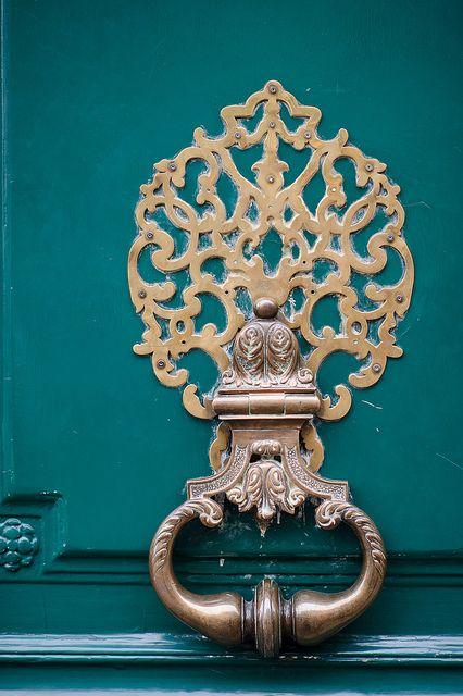 Beautiful Knocker in Paris, I love the way it pops off the teal door
